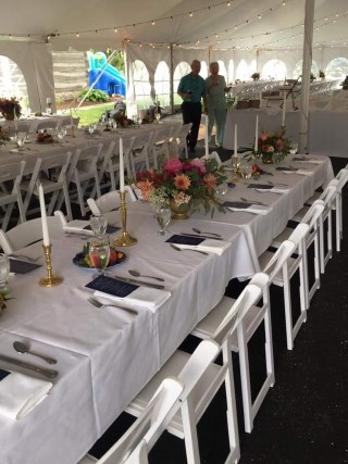 40' x 80' Pole Tent, White Padded Chairs, 8' Banquet Tables with White Linens, Cathedral Side Panels, Tent Lights.