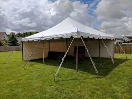 20' x 20' Pole Tent with Solid Side Panels.