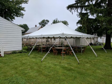"20' x 30' Pole Tent, Wood Chairs, 48"" Round Tables."