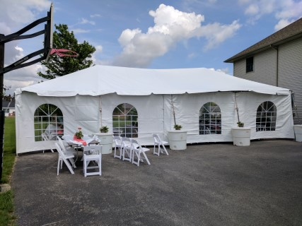 20' x 40' Frame Tent, Cathedral Side Panels, White Padded Chairs.