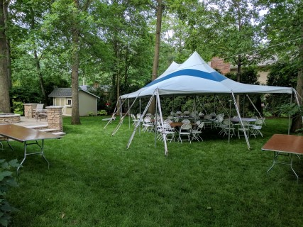 "20' x 30' Pole Tent with Blue Stripe, 6' Banquet Tables, 48"" Round Tables, White Steel/Plastic Fanback Chairs."