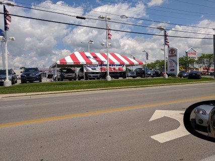 20' x 40' Red and White Striped Frame Tent.