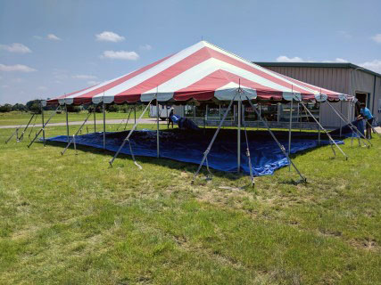 40' x 40' Red and White Striped Pole Tent.