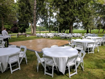 "White Padded Chairs, 60"" Round Tables, Linens, Dance Floor."