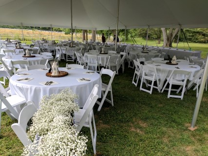40' x 60' Pole Tent, White Padded Chairs, Round Tables, Linens.