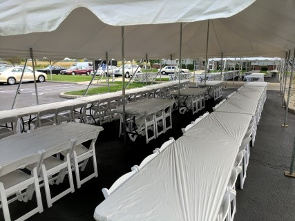 20' x 40' Pole Tent, White Padded Chairs, 8' Banquet Tables with White Plastic Table Covers (Quick 'Kwick' Covers).