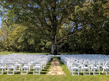 White Padded Chairs, Archway, PA System with Podium.