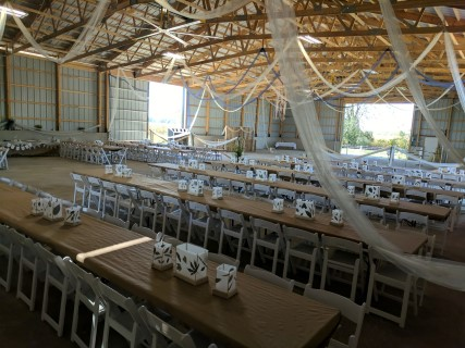 8' Banquet Tables, White Padded Chairs.